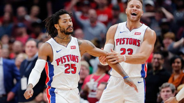 Detroit Pistons guard Derrick Rose (25) with forward Blake Griffin (23)